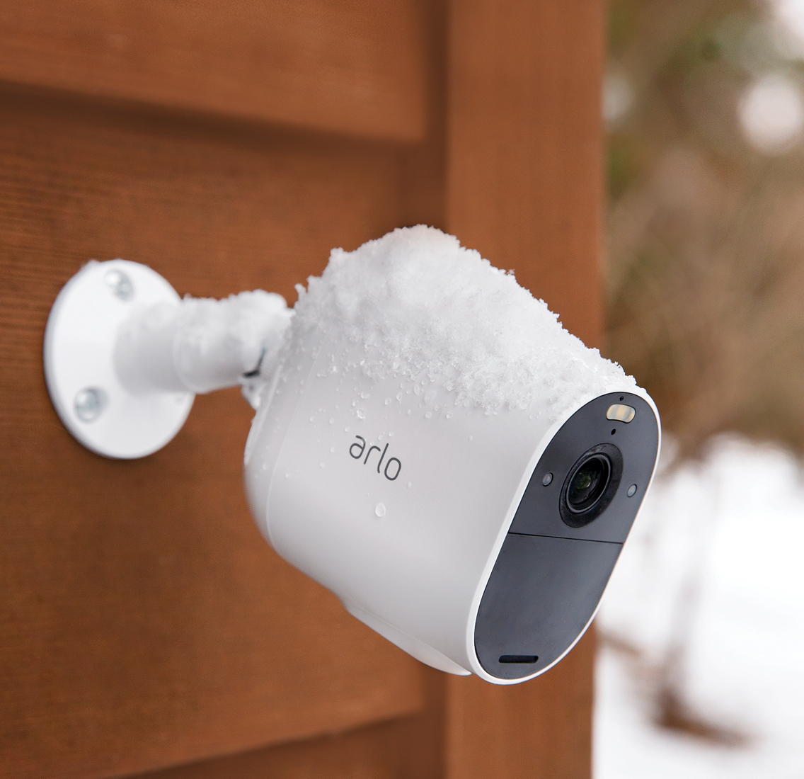 Arlo Essential Spotlight mounted on a wall.