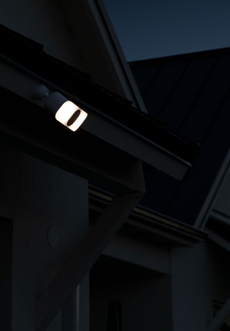 Pro3 Floodlight Camera mounted above garage during sunset