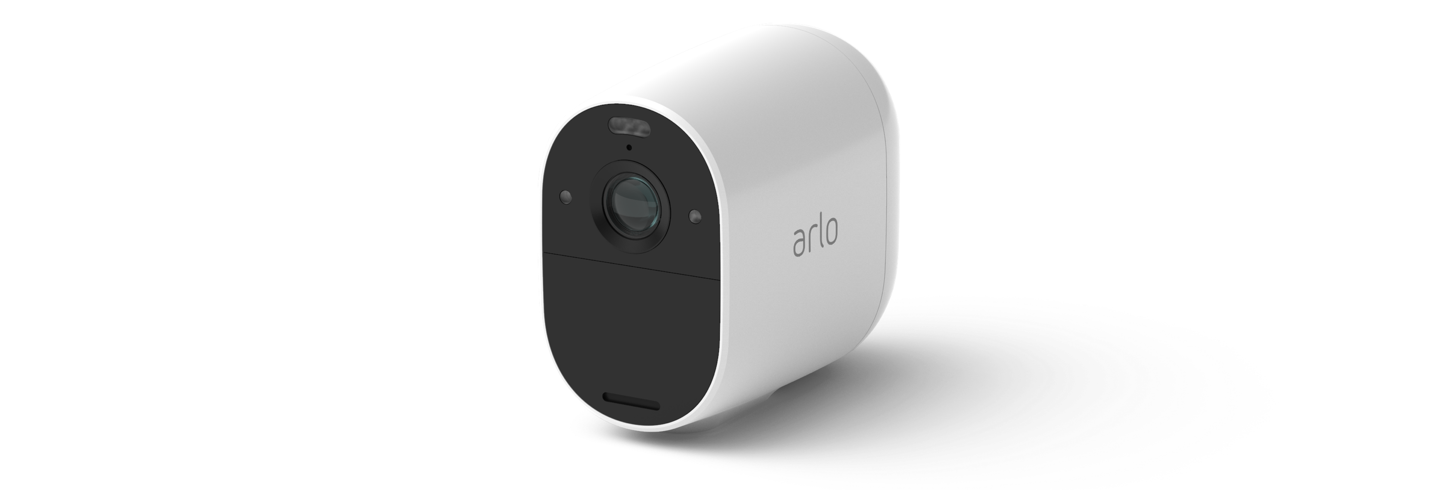 Arlo video doorbell mounted to a wall next to a green door