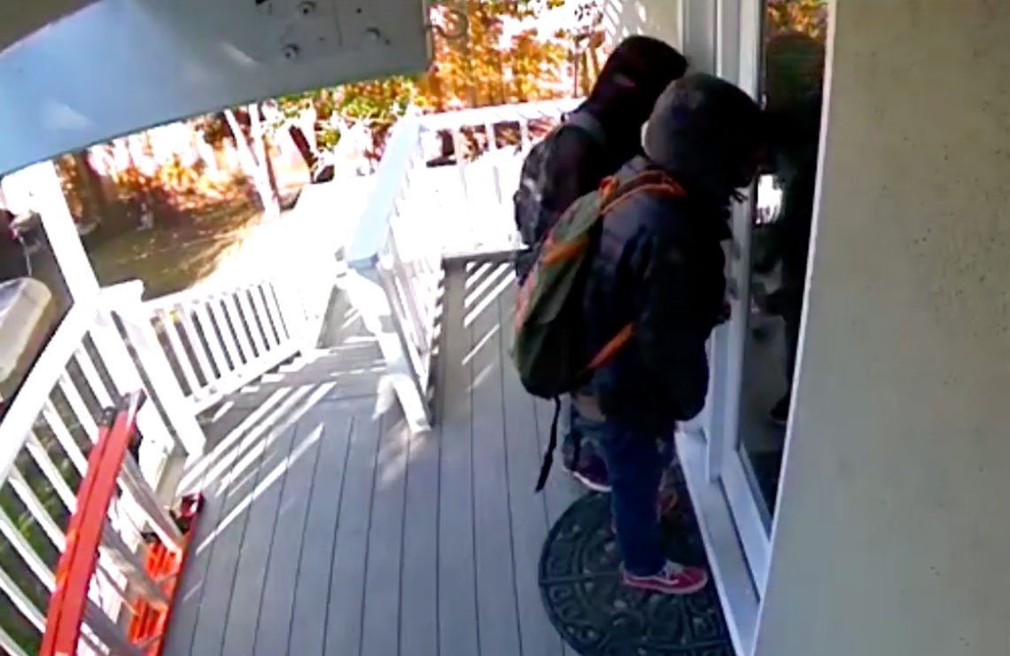 Video of three thieves planning break in